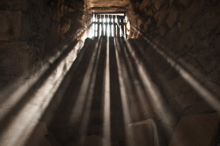 sun rays beaming through the jail window into the cell photo