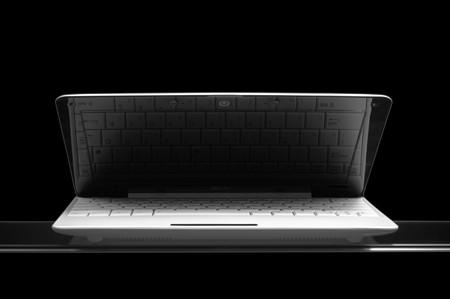 opened white notebook on glass isolated on black background Stock Photo - 7289836
