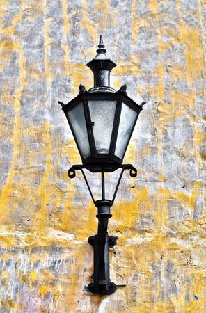 tallin: old lantern on yellow wall in street of Tallin old town, Estonia Stock Photo