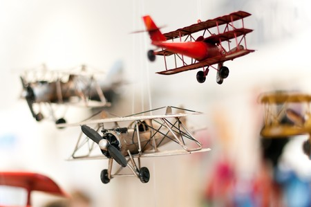 first plane: three old style toy planes with focus on first plane propeller, extremely shallow depth of filed