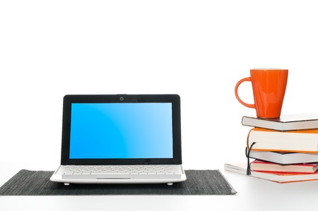 office work desk with laptop computer, pile of books and cup of coffee Stock Photo - 7289845