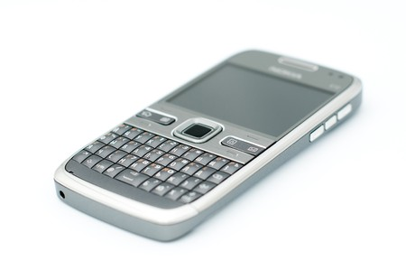 qwerty: mobile communication device (cell phone) with full qwerty keyboard isolated on white (extremely shallow focus zone) Stock Photo