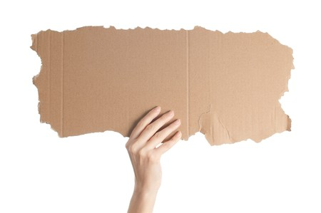 woman hand isolated on white background holding empty piece of cardboard with copy space for your text photo