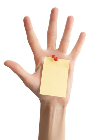 female hand with sticky office note isolated on white background . Note is blank and yellow photo