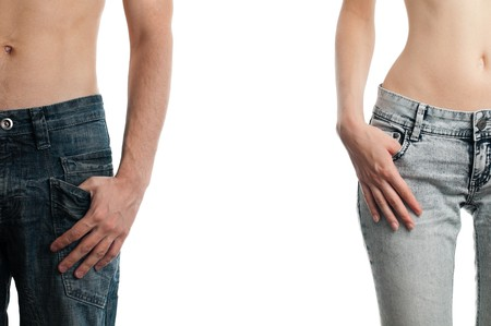 man and woman, hands in pockets of their jeans, isolated on white background Stock Photo