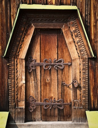 old beautiful wooden gate with ornate iron lock