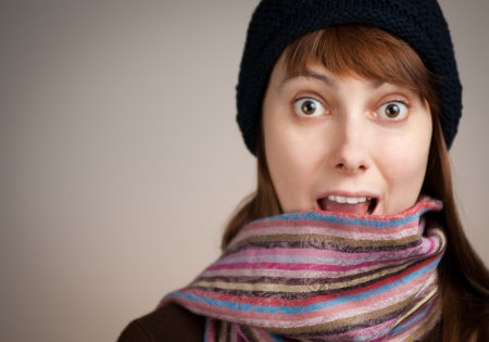 happy surprised beautiful young woman in winter clothes Stock Photo - 14813940