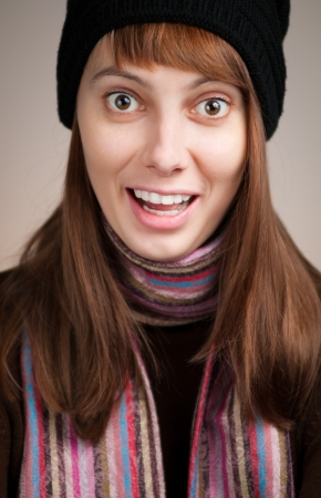 surprised beautiful young woman in winter clothes smiling Stock Photo - 14813942