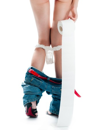 beautiful sexy woman with her back to camera standing with roll of toilet paper. Panties and jeans down. Isolated on white background Stock Photo - 8094794