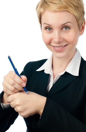 beautiful short haired blonde business woman making reminder on her hand with pen, smiling and looking into the camera. Isolated on white background photo