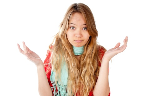 beautiful confused teenage girl with palms of her hands up by the sides of her shoulders, looking into the camera, isolated on white background photo
