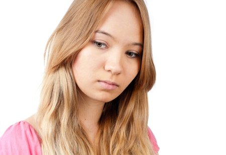 closeup of th beautiful teenage girl looking away from the camera with sad look at her face. Isolated on white background Stock Photo - 9007204