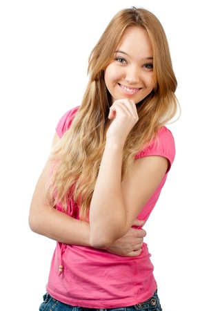 beautiful teenage girl smiling and looking into the camera, hand under her chin. Isolated on white background Stock Photo - 9007190