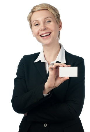 beautiful short haired business woman smiling, showing empty business card, isolated on white background photo