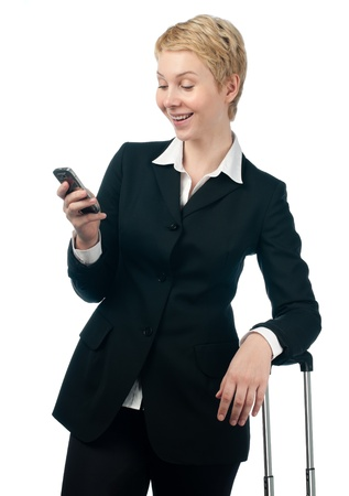 beautiful short haired blonde business woman holding mobile phone in her hand photo