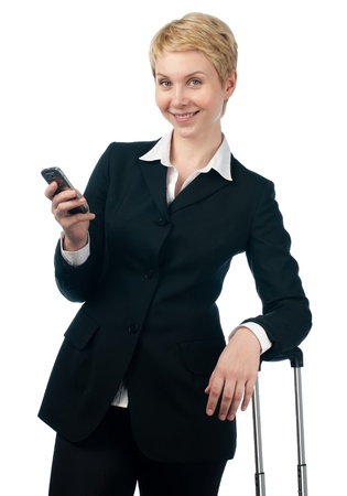 beautiful short haired blonde business woman holding mobile phone in her hand Stock Photo - 14821424