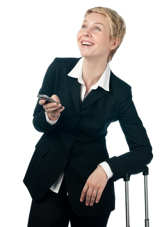 business woman holding mobile phone in her hand photo