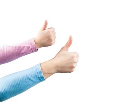 Hands of mother and daughter making thumbs up gesture. Isolated on white background. photo