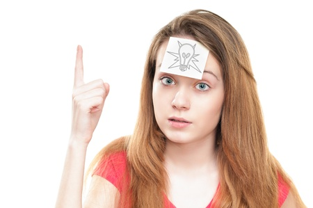 Young girl with small note paper on her forehead. Inspiration or idea concept.  photo
