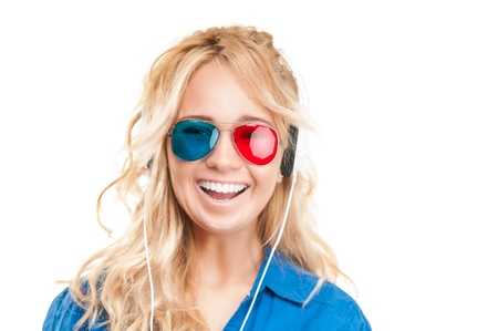 Beautiful and happy teenage girl watching 3d movie. Wearing 3d glasses and headphones. Smiling and looking into the camera, isolated on white background. photo