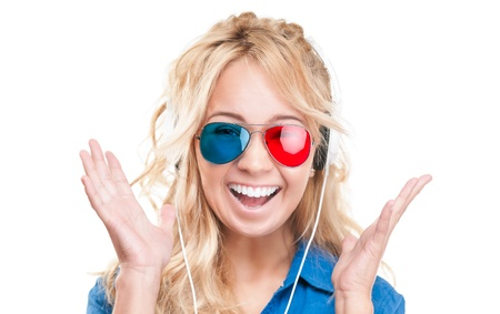 Beautiful and excited teenage girl watching 3d movie. Wearing 3d glasses and headphones.  photo