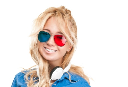 Beautiful and happy teenage girl watching 3d movie. Wearing 3d glasses and headphones.  photo