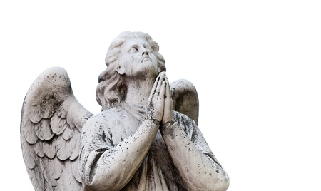 catholic angel: Beautiful statue of the angel praying. Isolated on white background