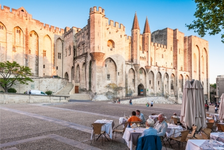 cote d'azur: AVIGNON - SEPTEMBER 9: Pope palace in Avignon. Central square with people sitting in front of the palace in the cafe. September 9, Provence, Alps, Cote dAzur, France, Europe.
