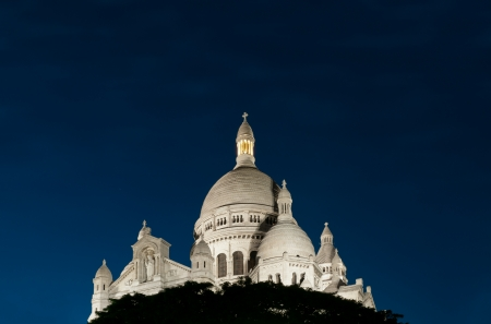 sacred heart: Night view of Basilica of the Sacred Heart of Paris with deep blue sky (Paris, France, Europe).