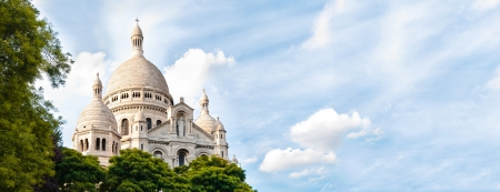 sacred heart: Panoramic view of Basilica of the Sacred Heart of Paris with blue cloudy sky in background (Paris, France, Europe).