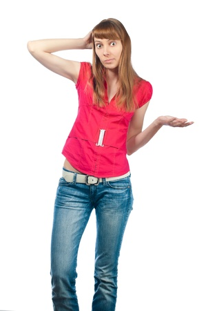 Beautiful and confused girl isolated on white background, hand at her head`s back, looking into the camera Stock Photo - 14848468