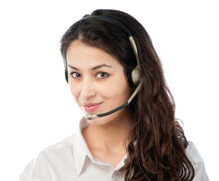 beautiful and young woman helpdesk operator with dark wavy hair looking into the camera and smiling. Stock Photo - 14848250