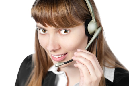 beautiful and happy young woman helpdesk operator. Headset on her head.  photo