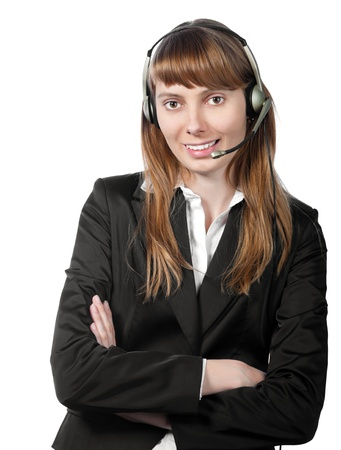 beautiful and happy young woman helpdesk operator. Headset on her head. Smiling and looking into the camera. Isolated on white background. Stock Photo - 15183386