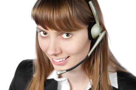 beautiful and happy young woman helpdesk operator. Headset on her head.  Stock Photo - 14848713