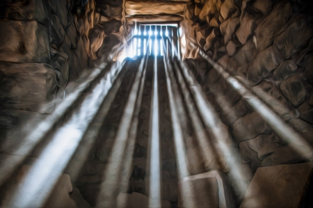 Sun rays beaming through the jail window into the cell. Stock Photo