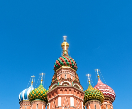 Wide angle view on the top of St. Basil Cathedral at nice summer day with clear blue sky in background.  photo
