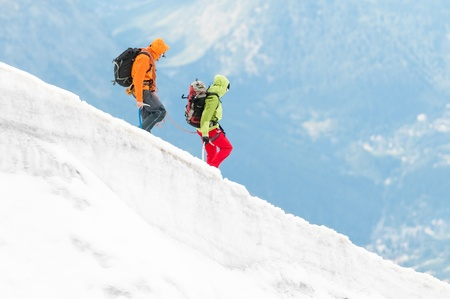 Two mountaineers on hike in snow mountains, Alps, Europe. photo