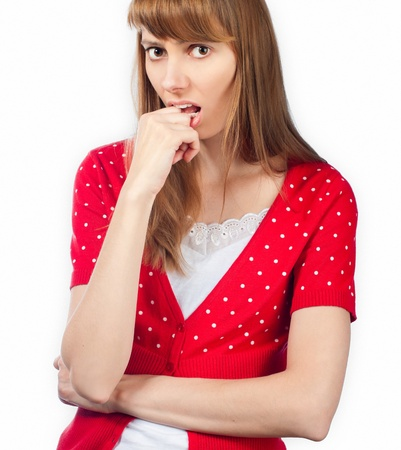 nervous beautiful young woman looking into the camera, hand at her mouth. Isolated on white background. Stock Photo - 14865350