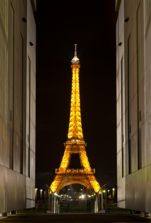 PARIS, FRANCE - SEPTEMBER 3: Illuminated Eiffel Tower at night. Dark night sky in background. The most popular tourist attraction in France. September 3, 2011, Paris, France, Europe.
