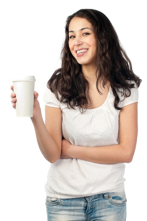 beautiful young woman with dark wavy hair smiling and looking into the camera, holding cup of coffee in her hand. Stock Photo - 14854929