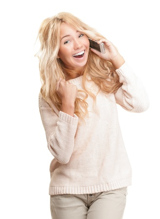 Young happy woman talking on phone with expression of surprise and joy isolated on white background. Stock Photo - 15183345