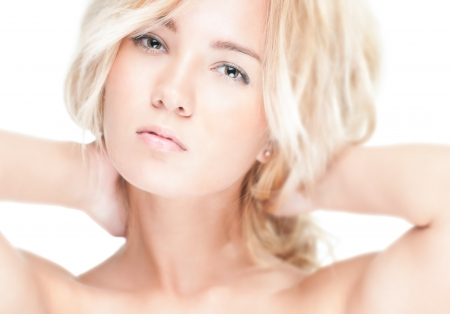 nude babe: Sensual portrait of young beautiful blonde woman on white background. Sexy topless girl with curly hair looking passionate and tempting. Youth, pure natural beauty and passion.