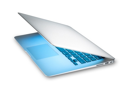 Modern silver aluminum laptop with blue light from screen isolated on white background. Popular thin computer in half open view. Stylish portable and mobile device. New technology and business. Stock Photo - 15086246