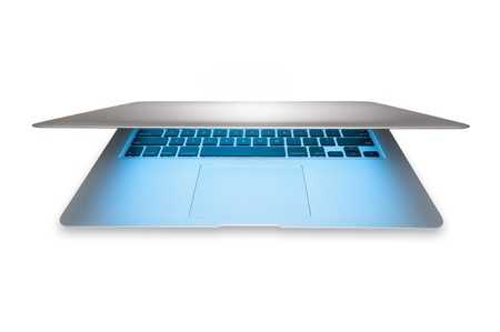 Modern silver aluminum laptop with blue light from screen isolated on white background. Popular thin computer in half open view. Stylish portable and mobile device. New technology and business. Stock Photo - 15086241