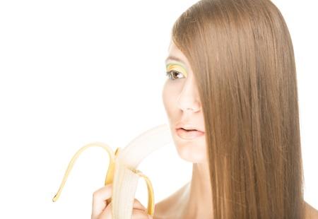 peeled banana: Beautiful young woman holding half peeled banana