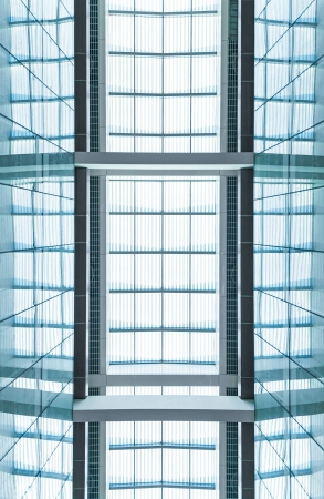 indoor inside: View through modern skylight of blue glass  Roof of building with square symmetric sections  Contemporary architectural style  Abstract backgrounds and backdrops