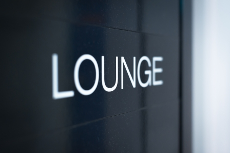 business lounge: Close up view of black sign with big white inscription Lounge  Having rest or comfortable waiting of flight with good service at airport  Business trips and travelling
