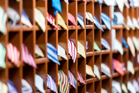 Rows of new colorful ties on shelves at shop
