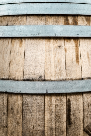 Detail of wooden barrel with iron hoops. Two different textures of wood and metal. Storage container used mostly for wine and beer. Abstract textured backgrounds and wallpapers. photo